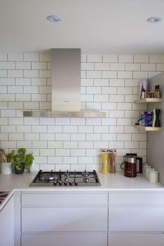 by andy korn architecture / matt metro tiles, silestone white quartz and matt grey handle-less units, matt metro tiles