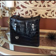Vintage Brighton purse This is an awesome classic Brighton purse, the outside of the back has a pocket for your phone or keys. The inside has a roomie compartment with a zipper pocket on one side. I have used this purse often and shows very little wear, the silver embellishments do show tarnishing but is hard to see Brighton Bags Shoulder Bags