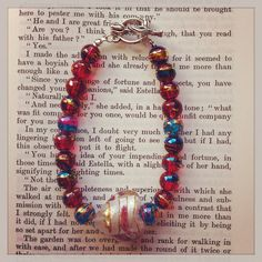 Red and Blue 'oily drizzle' beaded bracelet with Glass heart - made to order on Etsy, £8.00