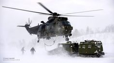 "Royal Navy Sea King Mk4 helicopter pilots and aircrews from Commando Helicopter Force (CHF) carry out a load lifting exercise as part of their Arctic flying training in Norway.  The training takes place some 200 miles inside the Arctic Circle at the Joint Helicopter Command (JHC) base near Bardufoss, Norway. The JHC base known as ""Clockwork"" provides survival and operational training and support facilities to enable aviation capable unit's arms to survive, operate and fight in extreme C2…"