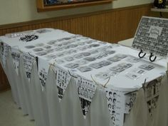 Entry table at our class reunion with name tags for all the classmates, decorated with copies of yearbook pages made into pennants.