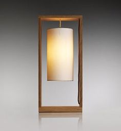 Elegantly suspended in an oak box frame with a fabric shade, this Conrad Wooden Frame table light lends a romantic feel to any interior. £79 from Marks and Spencer.