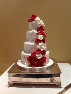 Elegant 4 tier wedding cake with silver ribbon and diamanté effect. Red and white rose cascade. Wedding cakes London, Hertfordshire, Essex and Kent. 4 Tier Wedding Cake, Wedding Cakes, Wedding Catering, White Roses, Our Wedding, Red And White, Bride, Elegant, Ribbon