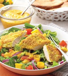Coconut Curry-Crusted Chicken Salad with Mango Dressing. Crisp salad is topped with a spiced coconut-crusted chicken breast in this salad that's a cinch to put together. Clean Eating Salads, Clean Eating Chicken, Chicken Curry Salad, Coconut Curry Chicken, Clean Eating Recipes, Healthy Recipes, Diabetic Recipes, Mango Dressing, Salad Sauce