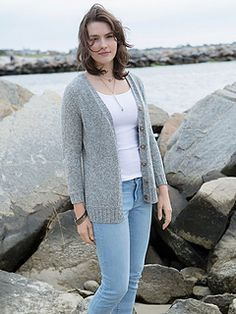A long and lean cardigan knitted from the top down with raglan shaping. The body is finished with a garter stitch welt and a split hem. Knit in Berroco Indigo, this cardigan is perfect for year round wear.