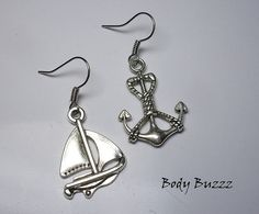 Nautical Boat earrings. mismatched boat and anchor by BodyBuzzz