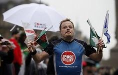 Run for your life: Eddie Izzard completes his run around the whole of the UK in 2009.