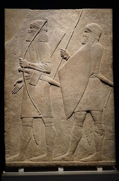 Assyrian Relief by Jade Koekoe -- This relief was found in Kuoyunjik (Nineveh ), Iraq (700-695 BCE) decorating a royal building of King Sennacherib . The archer is probably an Aramaean while the spearman could be from Levant .  This image was taken at the National Museum of Australia in the travelling exhibition A History of the World in 100 (and 1) Objects.