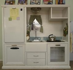 Made from an old entertainment center, refurbished as a child's kitchen center!