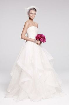 This tiered silk organza ball gown looks like it is straight from a fairy-tail.