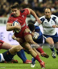 Wales's scrum half Rhys Webb is tackled by France's scrum-half Sebastien Tillous-Borde during the Six Nations international rugby union match between France and Wales on February 28, 2015 at the Stade de France in Saint-Denis, north of Paris. AFP PHOTO / FRANCK FIFE