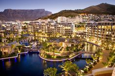 Cape Town is a port city on South Africa's southwest coast, on a peninsula beneath the imposing Table Mountain. Slowly rotating cable cars climb to the mountain's flat top, from which there are sweeping views of the city, the busy harbor and boats heading for Robben Island, the notorious prison that once held Nelson Mandela, which is now a living museum.