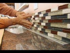 ▶ How to Install a Glass Tile Backsplash - YouTube Using a peel and stick double sided adhesive. Plus grout. EXCELLENT TUTORIAL