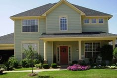 Sage Green Home Exterior Paint Color Schemes For Traditional Home Design With Decorative Front Yard And Red Door