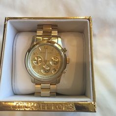 Michael Kors watch Authentic Michael Kors gold watch, NWT please no trades Michael Kors Jewelry
