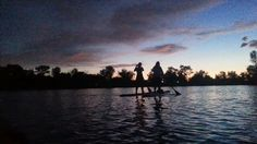 Two friends cstching the dunset on Quinn's Pond.