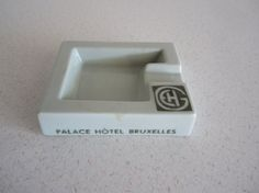 A funky art deco style vintage European hotel ash tray from Palace Hotel Bruxelles part of the Grands Hotels Europeens. It is stamped on the bottom D.F. Anvers Dupoint Fourdrigniers.