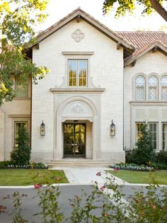 Beige siding with sandtone windows and european style roofing. Beautiful!