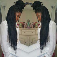 Long box braids with a bun.