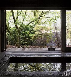 Restoration in Belgium. The home's interior design and the construction of two adjacent outbuildings were overseen by Axel Vervoordt