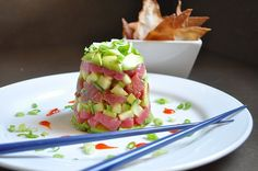 Tuna Poke - had my favorite version in Hawaii.  ...the tuna in a little soy, sesame oil, chili paste, sesame seeds, ginger and lime juice; some cucumber, green onion and a little avacado