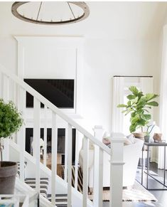 Kate Marker Interiors - Emily Kennedy Styling & Photography - Black striped runner on a white staircase adds dimension to the overall foyer design. Wood Handrail, Staircase Handrail, Staircase Runner, Wooden Staircases, Wood Stairs, Stairways, Stair Runners, White Hallway, White Staircase