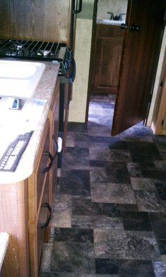 An RV should have a smooth, sweepable floor.  ESPECIALLY in the kitchen.