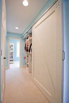 Barn door for shallow closet in hall.  I'm sensing a growing love for barn doors.
