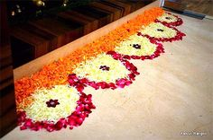 Big list Flower Rangoli Designs ideas and pictures for this ganesh chaturthi or any other Indian festivals. Learn flower rangoli designs for competition with flowers. Rangoli Designs Simple Diwali, Rangoli Simple, Rangoli Designs Flower, Rangoli Border Designs, Small Rangoli Design, Rangoli Patterns, Colorful Rangoli Designs, Rangoli Ideas, Rangoli Designs Images