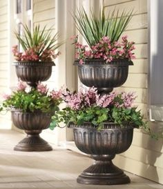 I like the look of this two tiered urn planter for a porch or patio