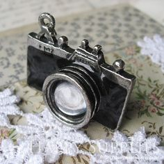 Pincube Power can help keep your camera charged up and ready to go making this the perfect accessory for the picture lover! 1Pcs Antique Sliver Black Camera Charms(BG315). $2,80, via Etsy.