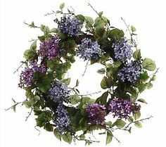 """24"""" Wispy Lilac Wreath - Welcome spring with this wispy lilac wreath. It's made using a grapevine base accented by silk lilacs in shades of purple with mixed green leaves. From the Valerie Parr Hill Collection on QVC."""