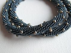 Grey hematite bead crochet necklace with Sterling dots | by Clarissa in 1000 Querce