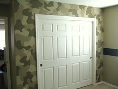 Camo around the closet, navy on the slant, and khaki green on the bottom half of the wall. That way he could keep his navy quilt. All of this along with the diy paratroopers!