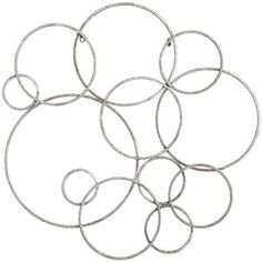 Hammered iron rings sculpted in interlocking circles put a signature on a feature wall in your home or office that's clean, direct and effusive—bubbly, even. Clearly modern, it's at home in traditional settings, too. Who can argue with bubbles, after all?