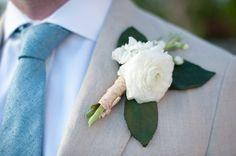 white boutonniere http://www.weddingchicks.com/2013/10/04/caribbean-destination-wedding-2/