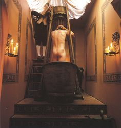 A Regency-style shower, where the footman pours the heated water into a tub with perforated holes.
