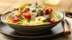 Farmers market favourite! Tomatoes, eggplant, squash and more create a fresh tasting meatless main dish.