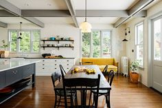 Updated Victorian kitchen with yellow and black by designer Jessica Helgerson (via Desire to Inspire).