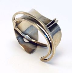 A lovely futuristic cuff c. 1947 from Ed Wiener.  The structure of this piece is just amazing.
