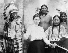 Unidentified white woman with group of Sioux