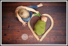 Newborn Photo - Heart Train Tracks. We'd have to modify it since there won't be a big brother, but I think a photo like this in our baby's train-themed nursery would be perfect!