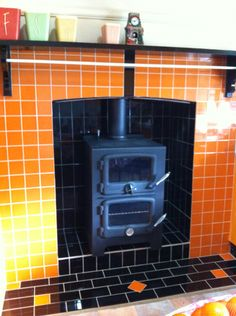 A wood fired bakers oven set in newly tiled chimney cavity. Can cook many things with this whilst heating your home as well. Also has optional wetback to heat your water. Five Star Fireplaces installed this.