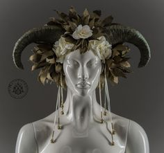 Hailing from the lush green pastures of Arcadia, this headdress is a regular horn of plenty. Brimming with lovely foliage, flowers and textures. The