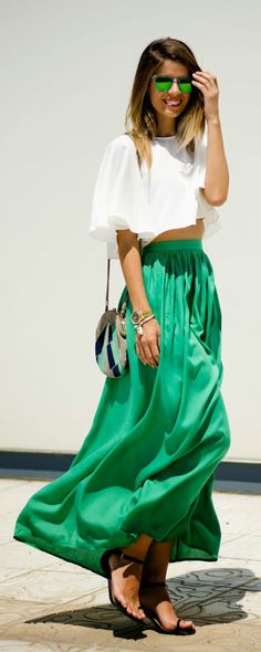 Gorgeous pakistani green pleated maxi skirts with top white short blouse and cute leather hand bag and black shoes and green awesome goggles the best way to show fashion & style