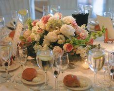 https://bellaflowersinc.files.wordpress.com/2013/05/bella-flowers-centerpiece-with-candles-4.jpg    nice shape to centerpiece