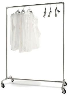 Industrial metal pipe clothes rack on wheels. threaded metal pipe and connectors screwed together - Closet Ideas - Closet Room - Closets - Feng Shui Design Your Closet for Balance and Harmony with a Professional Consultation at the link.