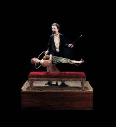 Extremely Rare French Illusionist Automaton.At first the magician leans forward while waving his wand,fixing his gaze so as to hypnotize the lady. She slowly stops fanning herself and closes her eyes,falling into a sleeplike state,yet receptive to his suggestions. In her trance she rises,her body horizontally suspended in mid-air. The magician then passes the hoop fully across her body several times.