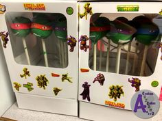 Ninja turtle cake pops, vanilla cake, chocolate frosting covered in candy melt and decorated with gum paste