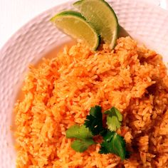 Mexican Rice 1 can Rotel (diced tomatoes with green chiles) 1/2 Medium onion (quartered) 2 cups White Rice 1/3 cup canola oil or vegetable oil 2 cloves garlic (minced) 1 3/4 cup low sodium chicken broth 1 tablespoon tomato paste 1 1/2 teaspoon salt